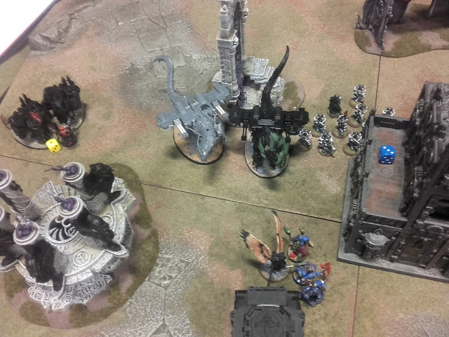 Warhammer 40K Battle report: The Saint charged the survivors and for a force activated axe to the face!