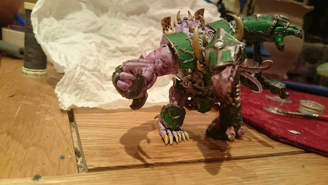 This Hellbrute is all done but the base and proper mutated it is and all.