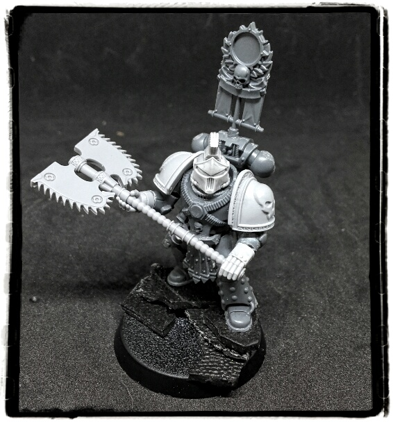 Space marine using a bloody huge chain axe