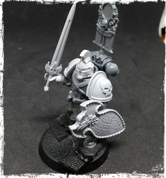 Space marine with a power sword and shield
